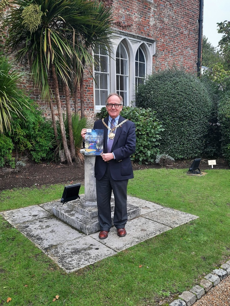 Image of Hertford Mayor Cllr Bob Deering with the Calendar in Hertford Castle Grounds
