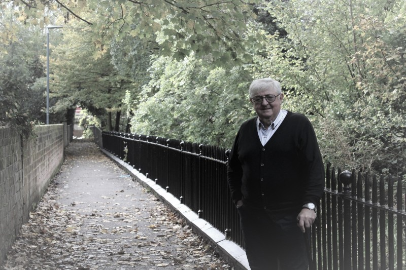 Image of Cllr John Lynch MBE admiring the repainted railings
